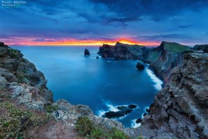 colorful-sunset-at-a-cliff-at-canial-madeira-island-madrid-portugal-by-miguel-nbrega-36675